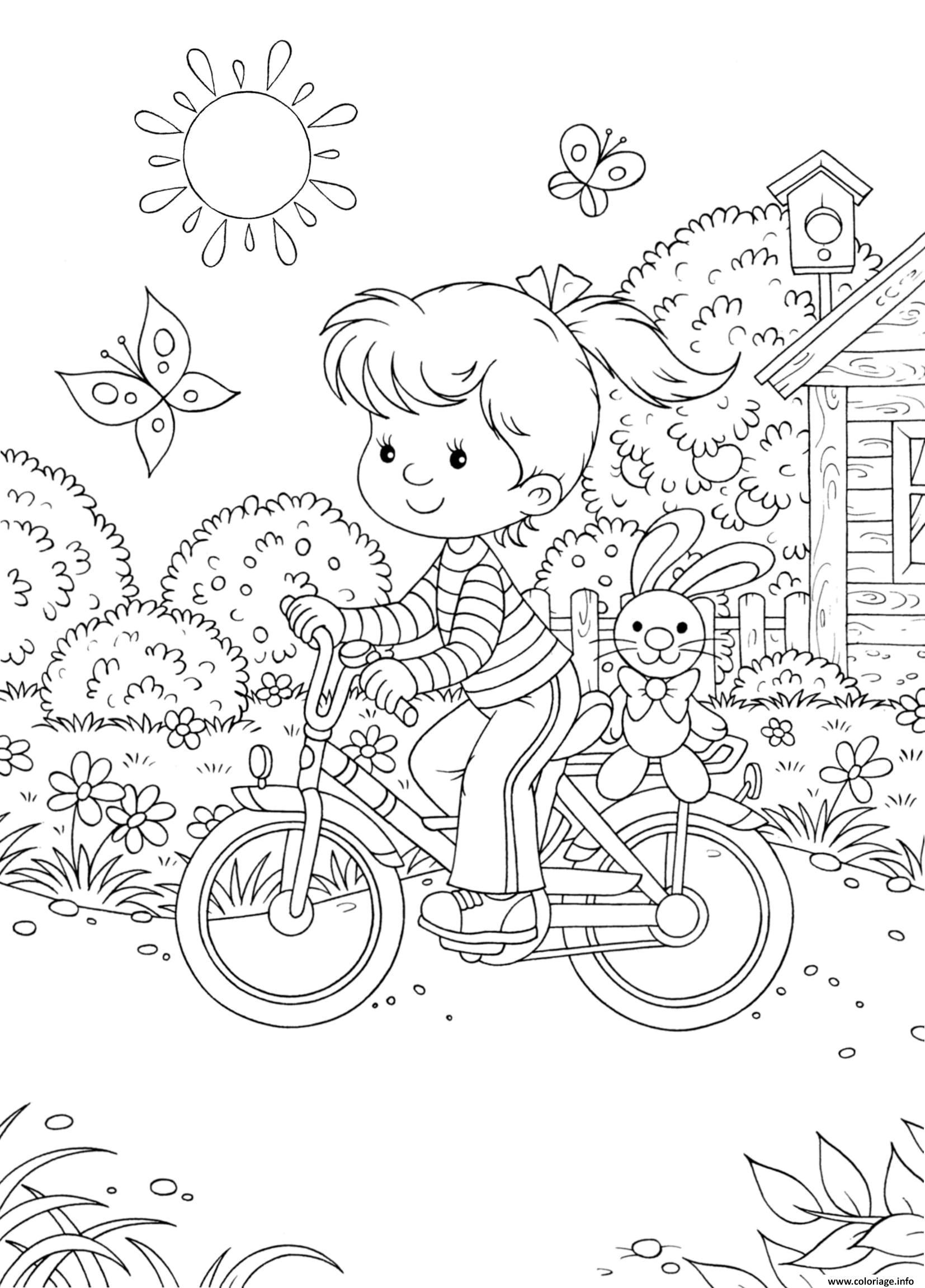 Coloriage petite fille fait de la bicyclette - JeColorie.com