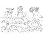 enfants cuisinent gateaux noel dessin à colorier