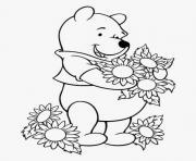 winnie de pooh aime les fleurs dessin à colorier