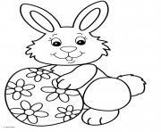 jolie lapin souriant avec un oeuf de paques motif fleurs dessin à colorier