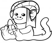 un singe mignon en turban avec une banane dessin à colorier