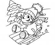 une petite fille glisse sur une montagne de neige en hiver dessin à colorier
