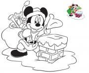 mickey le pere noel pres de la chemine pour distribuer des cadeaux dessin à colorier